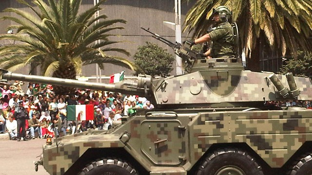 PHOTO:&nbsp;An armed vehicle parades the streets of Mexico City during recent independence day celebrations. Over the past six years the Mexican government has increasingly deployed the military to fight drug gangs around the country.