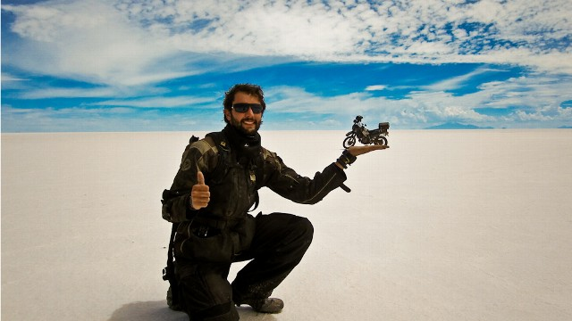 PHOTO: Alex Chacón creates an optical illusion in Bolivia's Uyuni salt flat. Chacón a 25-year-old from El Paso, Texas travelled from Alaska to the southern tip of Argentina on a Kawasaki motorbike. He traveled for more than 500 days.