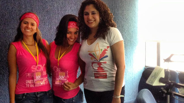 PHOTO: Valentina Robledo [left] and Vanessa Posada [center] pose for a picture at a Pereira radio station on the day that they organized the March of the Mirrors.