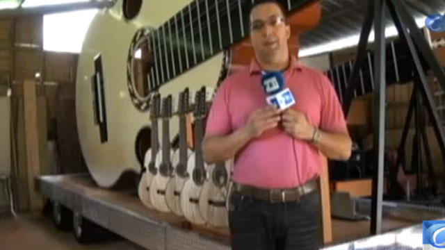 PHOTO:Luis Colon Ortiz, built a 30 foot long version of Puerto Ricos iconic instrument, the Cuatro. It could be the worlds largest acoustic instrument.
