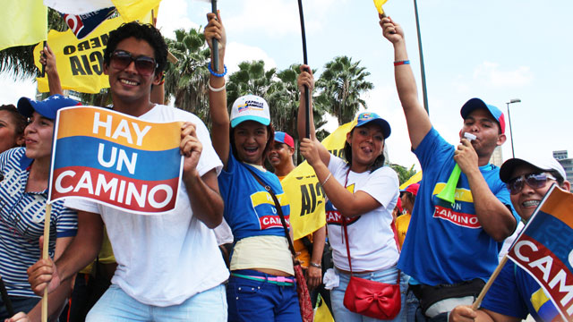 PHOTO: Young supporters of opposition candidate Henrique Capriles at a rally in Caracas. Four out of 10 Venezuelan voters are between the ages of 18 and 34.