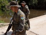 PHOTO: Soldiers patrol in San Valentin in Guatemala´s remote El Peten region,  near the border with Mexico.
