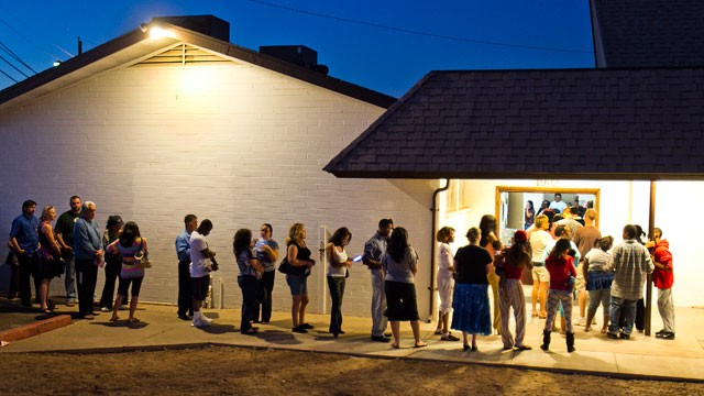 PHOTO:&nbsp;People wait in line to vote at the First New Life Missionary Baptist Church at 19th Ave. and Roeser, Tuesday, Nov. 6, 2012 in Phoenix.