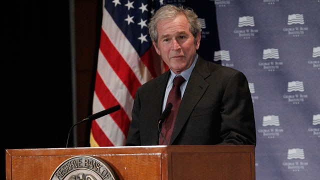 PHOTO: Former President George W. Bush gives opening remarks at the Federal Reserve Bank of Dallas for a conference titled