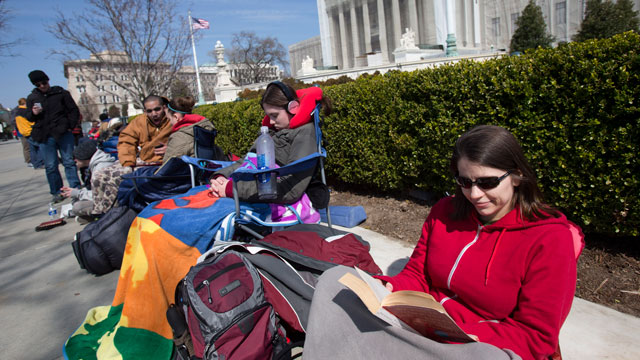PHOTO: In this photo taken Saturday, March 23, 2013, Jessica Skrebes of Washington reads while waiting in line with others outside of the U.S. Supreme Court in Washington.
