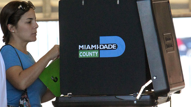 PHOTO: A woman casts her vote at Hialeah Fire Station #5 in Hialeah, Fla. on Election Day Tuesday, Nov. 6, 2012.