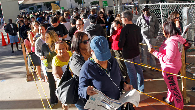 In this Nov. 3, 2012, photo, South Floridians stand in line during the last day of early voting in Miami.