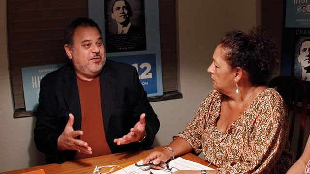 PHOTO: In this Oct. 10, 2012 photo, Frank Nieves, of the Puerto Rican/Hispanic Chamber of Commerce, left, talks to phone bank volunteer Ana Sofia Ballen, of the Hispanics for Obama organization, in Cooper City, Fla. Puerto Ricans and Cubans are the larges