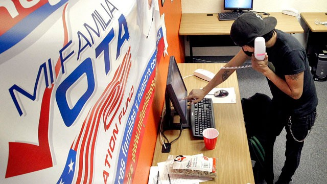 PHOTO: Pedro Yazzie, 27, makes phone calls Tuesday, Nov. 6, 2012 in Phoenix to registered voters from the offices of Mi Familia Vota, a non-partisan effort to increase voter participation among Latinos and others.