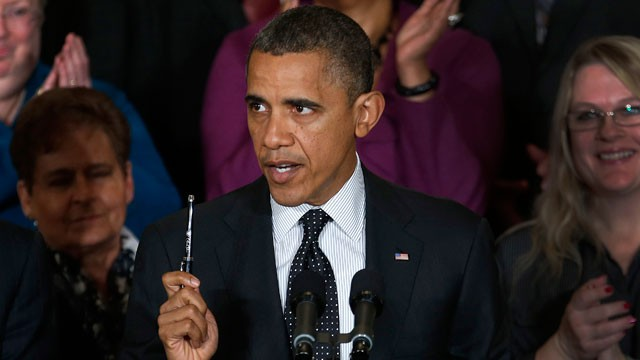 PHOTO: President Barack Obama holds up a pen as he speaks about the economy and the deficit, Friday, Nov. 9, 2012, in the East Room of the White House in Washington.