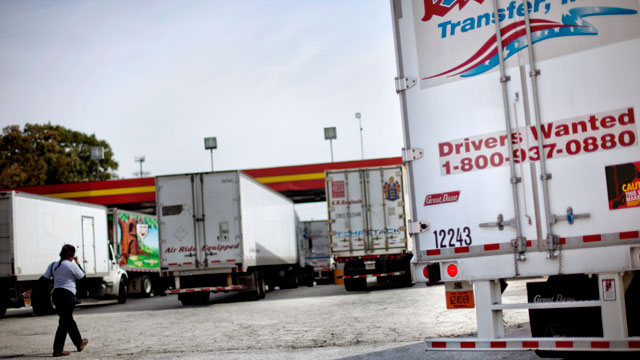 PHOTO: A sign on the back of a truck advertises job openings at a truck stop Tuesday, Oct. 30, 2012, in Atlanta. Even amid a struggling economy with high unemployment, trucking companies had a tough time hiring young drivers willing to hit the road for lo