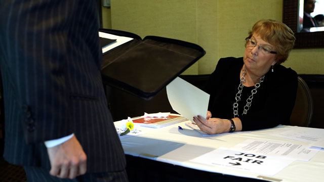 PHOTO: , Patti Maurer of Pompano Beach, Fla., right, registers a job seeker at a job fair held by National Career Fairs, in Fort Lauderdale, Fla.