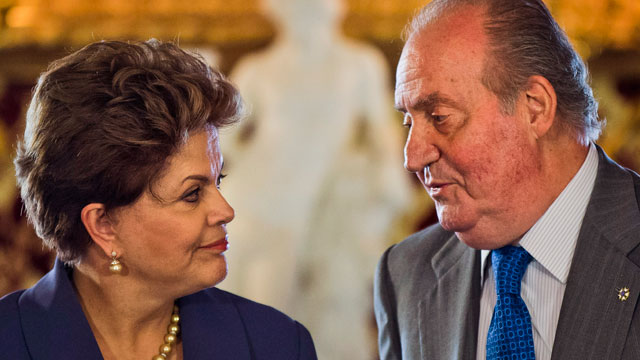 PHOTO: Spains King Juan Carlos is all ears as he welcomes Brazil?s President Dilma Rousseff at the Royal Palace, in Madrid, Monday, Nov. 19, 2012.