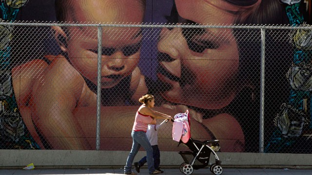 PHOTO: A mother walks with her children to the MacArthur Park Primary Center School in Los Angeles Thursday, Jan. 31, 2013. Within six months, California's Hispanic population will equal that of whites.