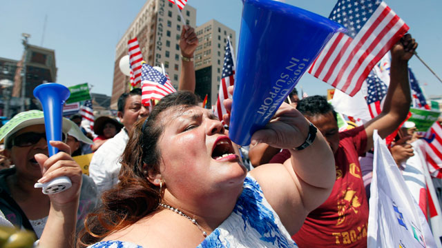 PHOTO:Emilia Hernandez shouts during a May Day rally in downtown Los Angeles on Wednesday, May 1, 2013.