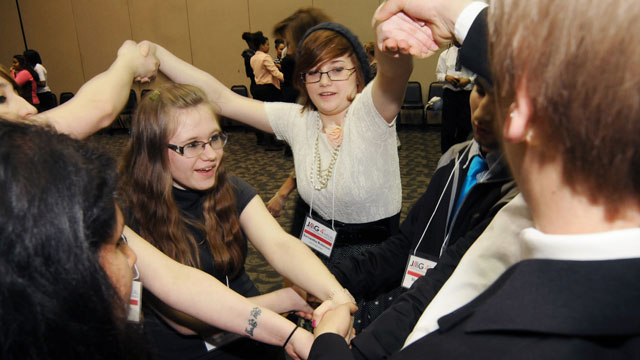 PHOTO: Students participate in a human knot exercise Wednesday, April 10, 2013, during the fourth annual JAG Career Development Conference held at Lake Michigan Colleges Mendel Center. JAG is an effort to prepare students for the workplace.