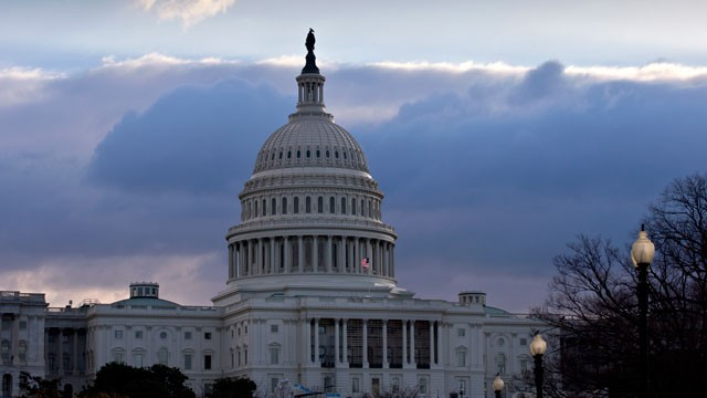 PHOTO: The U.S. Capitol is seen as Congress convenes to negotiate a legislative path to avoid the so-called