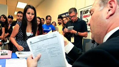 PHOTO:Gaby Perez, left, hands over all her paperwork to get guidance from immigration attorney Jose Penalosa, right, in Phoenix on August 15, 2012, for a new federal program, called Deferred Action, that would help some young undocumented immigrants avoi