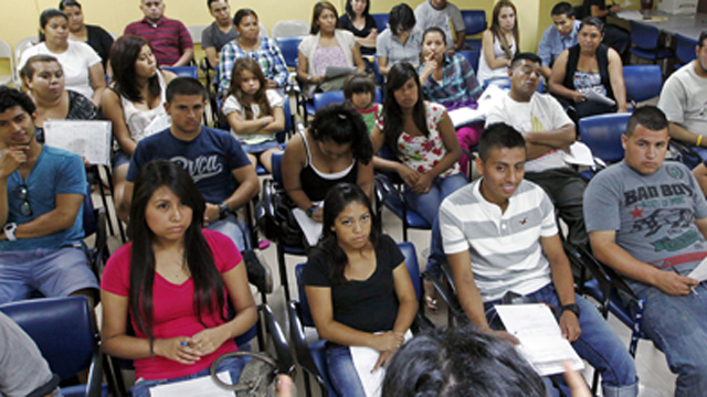 PHOTO: In this Thursday, Sept. 20, 2012 photo , Charlene Gomez leads an orientation seminar for undocumented immigrants.