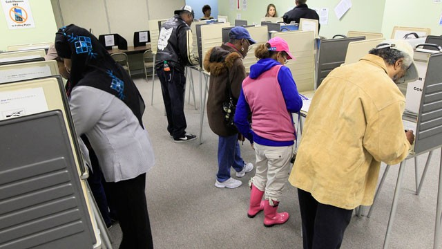 PHOTO:&nbsp;People vote inside the Hamilton County Board of Elections after it opened for early voting, Tuesday, Oct. 2, 2012, in Cincinnati. Ohioans can cast an early ballot by mail or in person beginning Tuesday for the Nov. 6 election.