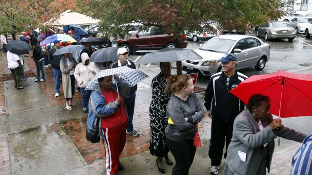 PHOTO: Voters wait in line despite rains from Hurricane Sandy to vote on the last early voting Sunday before election day, in New Bern, N.C., on Oct. 28, 2012. Early voting ends in Craven County on November 3.