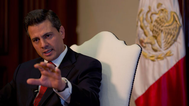 PHOTO: Enrique Peña Nieto speaks during an interview with The Associated Press at the Los Pinos presidential residence in Mexico City, Monday, Dec. 10, 2012.
