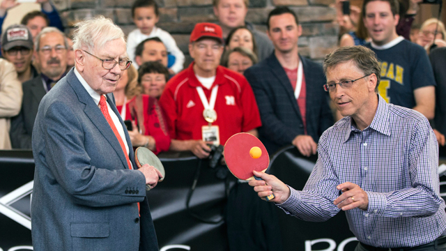 PHOTO: Berkshire Hathaway Chairman and CEO Warren Buffett, left, and Microsoft founder and Berkshire director Bill Gates are watched by shareholders as they play table tennis in Omaha, Neb., Sunday, May 5, 2013.