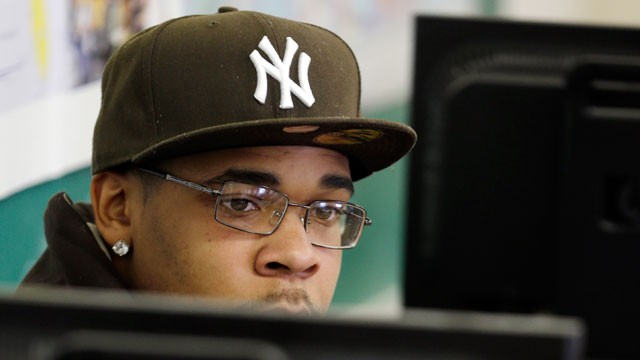 PHOTO: Student Demarcus Miller listens to a teacher from behind a computer terminal in a GED preparation class in Buffalo, N.Y., Tuesday, Feb. 5, 2013.