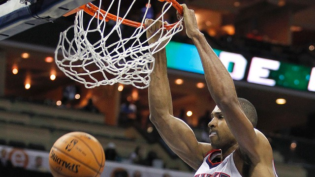 PHOTO:&nbsp;Atlanta Hawks' Al Horford (15) dunks during the second half of an NBA basketball game in Charlotte, N.C., Friday, Nov. 23, 2012. The Hawks won 101-91.