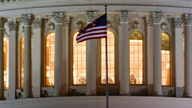 PHOTO: The U.S. flag flies in front of the U.S. Capitol in Washington as Congress works into the late evening Sunday, Dec. 30, 2012 to resolve the stalemate over the