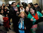 PHOTO: Supporters of granting undocumented immigrants drivers licenses cheer after a House committee hearing at the Illinois State Capitol Monday, Jan. 7, 2013, in Springfield Ill.