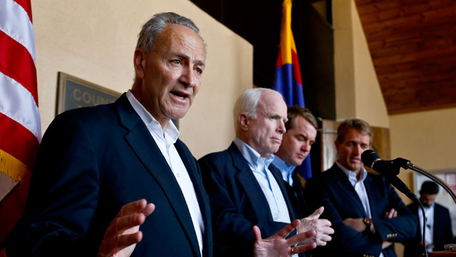 PHOTO: Sen. Chuck Schumer, D-N.Y., left, speaks to the media as, from second left, Sen. John McCain, R-Ariz., Sen. Michael Bennett, D-Colo., and Sen. Jeff Flake, R-Ariz., listen in