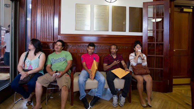 PHOTO:&nbsp;This Aug. 15, 2012 file photo shows applicants waiting in Casa de Maryland in Langley Park, Md., to apply for the Deferred Action Childhood Arrivals.