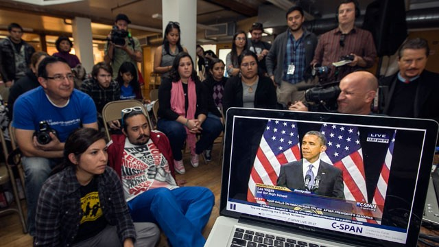 PHOTO: Members of the DREAM Team LA watch President Obama speak about immigration in Los Angeles, Tuesday, Jan. 29, 2013.