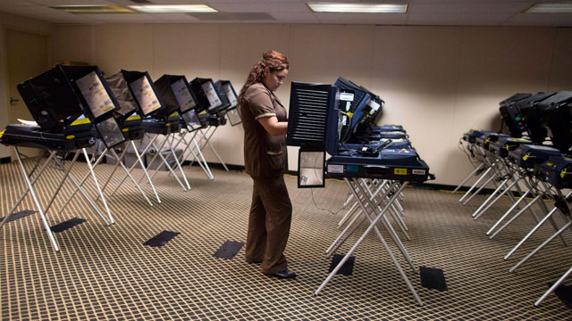 PHOTO:A woman who works in the housekeeping department of a Las Vegas Strip casino casts her ballot at an early voting polling placce, Saturday, Oct. 20, 2012, in Las Vegas.