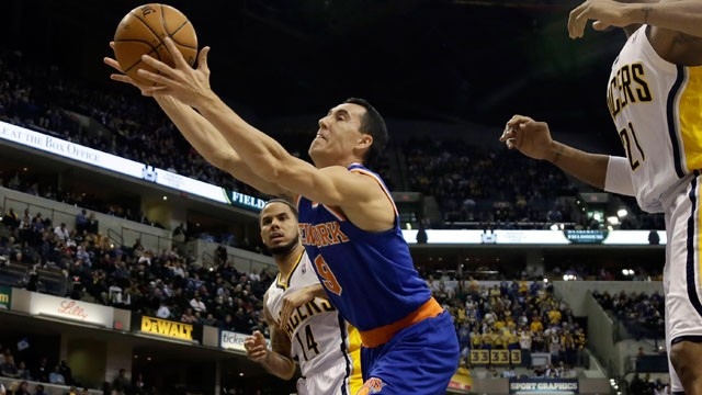 PHOTO:  New York Knicks guard Pablo Prigioni (9), of Argentina, goes for a rebound.