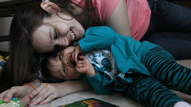 PHOTO:In this Tuesday, March 26, 2013, photo, Adreanna Guiterrez, 18, plays with daughter Alicia Elena Garcia in their foster home in Houston.