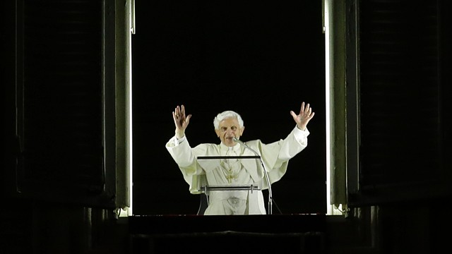 PHOTO: Pope Benedict XVI blesses the faithful gathered for a candlelight procession.