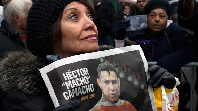 "PHOTO: Magaly Diaz, of New York, watches as a procession carries Hector ""Macho"" Camacho's casket after a funeral at St. Cecilia's Roman Catholic Church in New York, Saturday, Dec. 1, 2012. D"