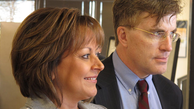 PHOTO: New Mexico Gov. Susana Martinez is shown with MVD director Mark Williams at an Albuquerque MVD office, Wednesday Jan. 23, 2013, as she unveils a new online system for drivers license renewal.