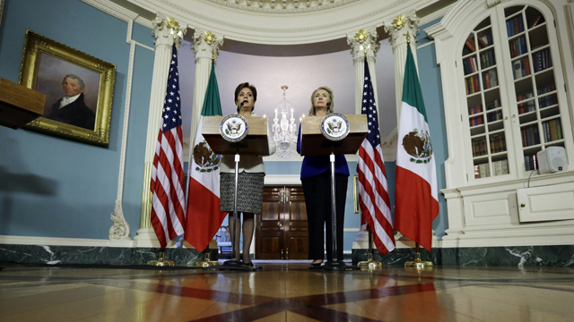PHOTO: Secretary of State Hillary Rodham Clinton, right, and Mexican Foreign Minister Patricia Espinosa speak in the Treaty Room of the State Department, Tuesday, Sept. 18, 2012, in Washington.