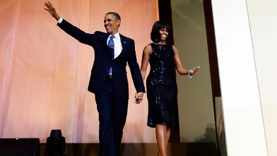 PHOTO: President Barack Obama and first lady Michelle Obama arrive to speak to supporters and donors at an inaugural reception for the 57th Presidential Inauguration at The National Building Museum in Washington, Sunday, Jan. 20, 2013.