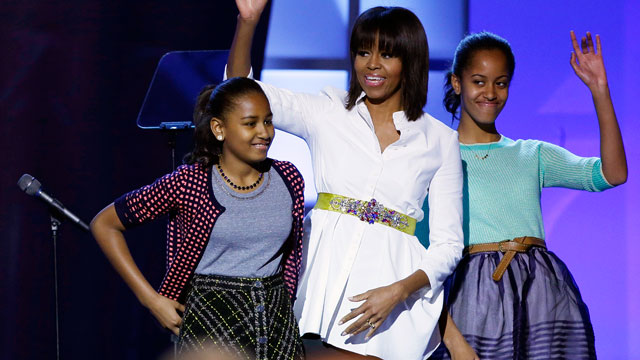 "PHOTO: First lady Michelle Obama, center, and daughters Sasha, left, and Malia, right, react during the Kids' Inaugural: Our Children. Our Future."" event in Washington, Saturday, Jan. 19, 2013."