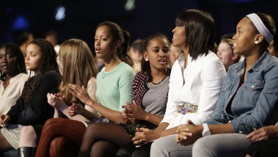 PHOTO:First lady Michelle Obama and daughters Sasha, center, and Malia react as Usher performs during the Kids' Inaugural: Our Children. Our Future.&quot; event in Washington, Saturday, Jan. 19, 2013.