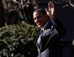 PHOTO: President Barack Obama waves to reporters as they shout questions to him regarding the fiscal cliff as he walks across Pennsylvania Avenue back to the White House in Washington, Thursday, Dec. 13, 2012