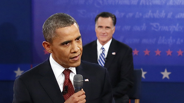 PHOTO: President Barack Obama answers a question as Republican presidential nominee Mitt Romney listens during the second presidential debate at Hofstra University, Tuesday, Oct. 16, 2012, in Hempstead, N.Y.