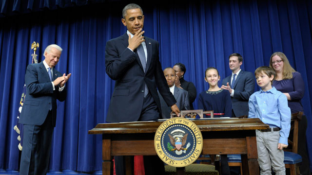 PHOTO:President Barack Obama, accompanied by Vice President Joe Biden and children who wrote the president about gun violence following last months shooting at an elementary school in Newtown, Conn., prepares to sit down to sign executive orders.