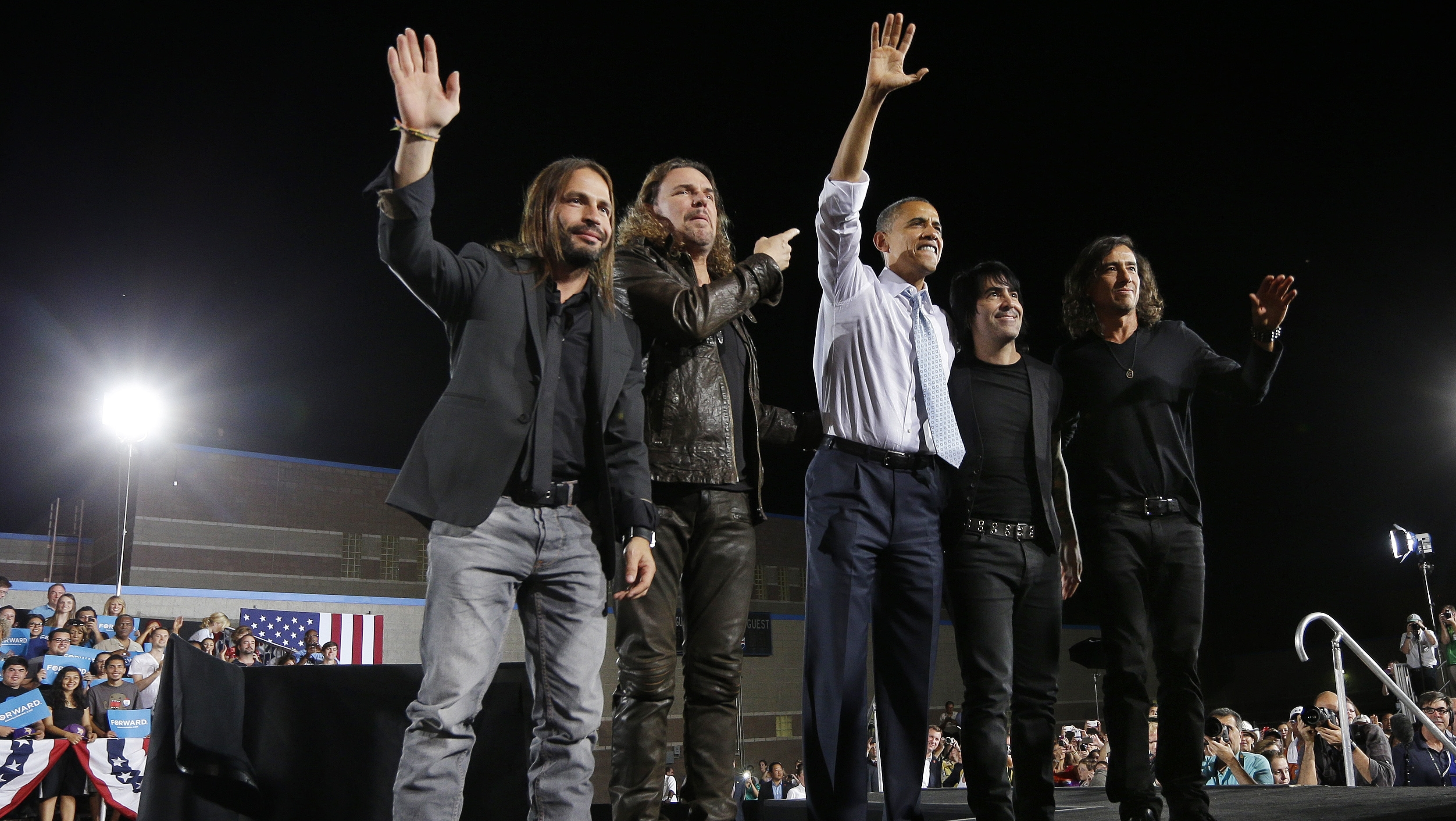 PHOTO:President Barack Obama, center, on stage with members of the Mexican Rock Band Mana, during a campaign event in Desert Pines High School, Sunday, Sept. 30, 2012 in Las Vegas.