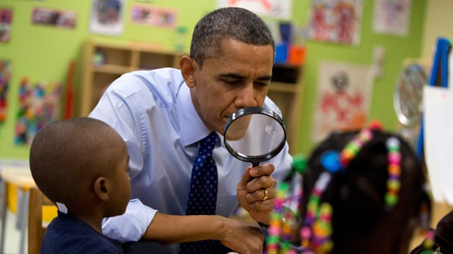 PHOTO: President Barack Obama looks through a magnifying glass during a learning game at a pre-kindergarten classroom at College Heights Early Childhood Learning Center in Decatur, Ga., Thursday, Feb. 14, 2013.