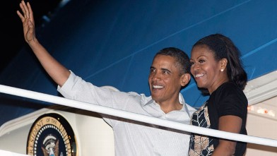President Barack Obama and first lady Michelle Obama board Air Force One at Honolulu Joint Base Pearl Harbor-Hickam, Saturday, Jan. 5, 2013, in Honolulu, en route to Washington after their holiday vacation.
